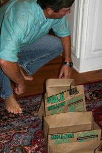 Rob gathering grocery bags with only his teeth. Limber back is all I've gotta say!